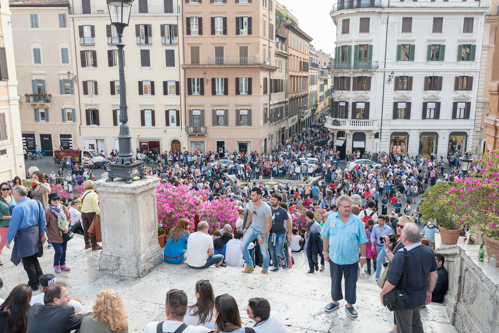 Numerous tourists glogging the Spanish Steps and the  Piazza di Spagna below.