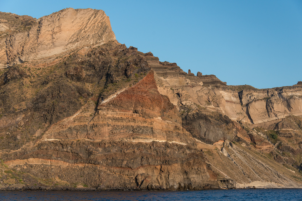 Back at the Santorini coast with its multi-colored rocks.