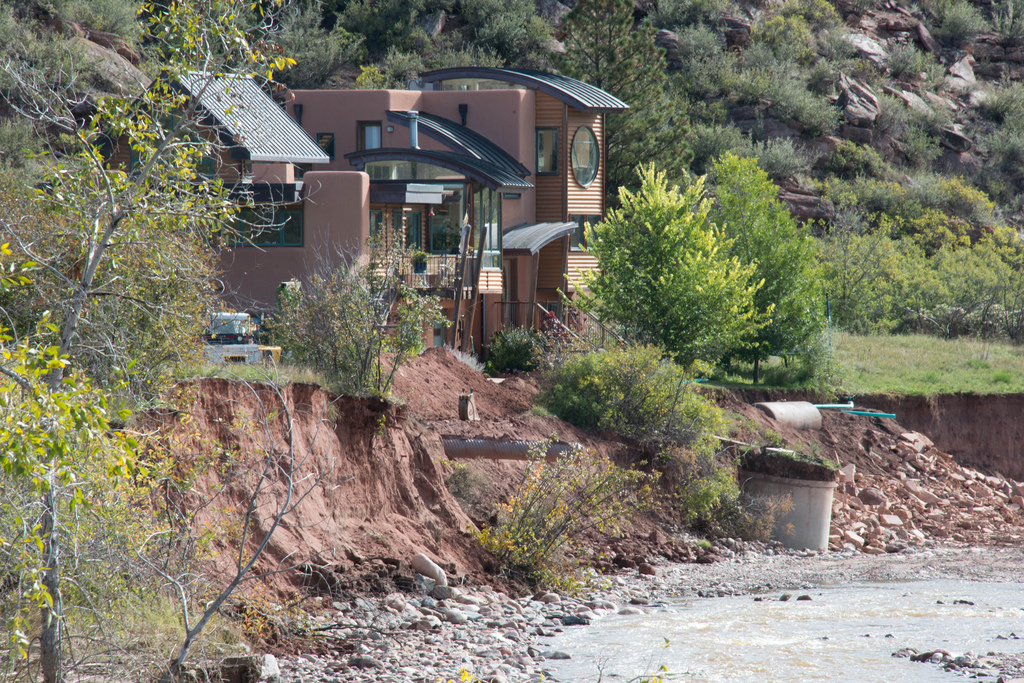 Gale and Gregory's house after the flood. The Little Thompson eroded away about 200 feet of meadow and came very close to their house.