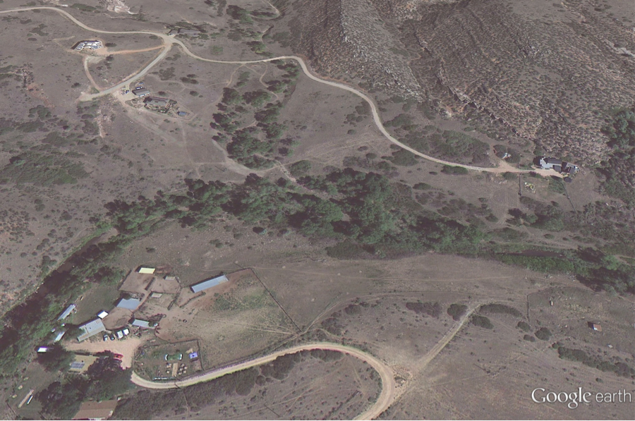 A Google Earth picture of River Way before the September 2013 flood. In the middle of the picture is our property; many mature cottonwood trees line the Little Thompson River. Gail and Gregory's house at the right is about 200 feet from the water; on the left, the old 1858 Buster homestead with its numerous outbuildings.