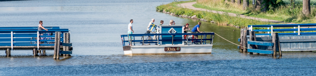 """""""The World's Smallest Ferry,"""" the Lina. It will take you across the canal for 1 Krone. The crossing takes 20 seconds."""