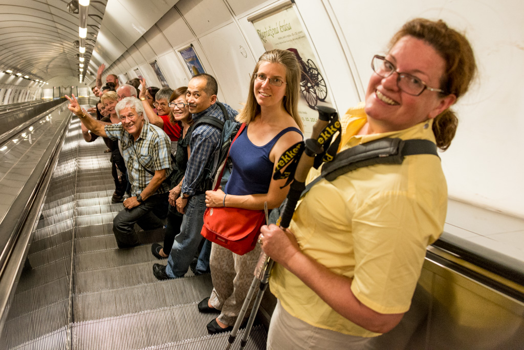Riding the loooooong escalator down to the metro, with our tour group.