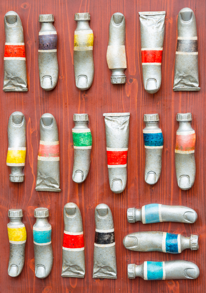 Artistic flair was everywhere. These are old paint tubes, embossed to look like thumbs.
